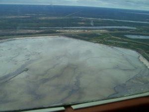 "Giant tailings waste ""pond"" produced by the Suncor Millenium and Steepbank operations."
